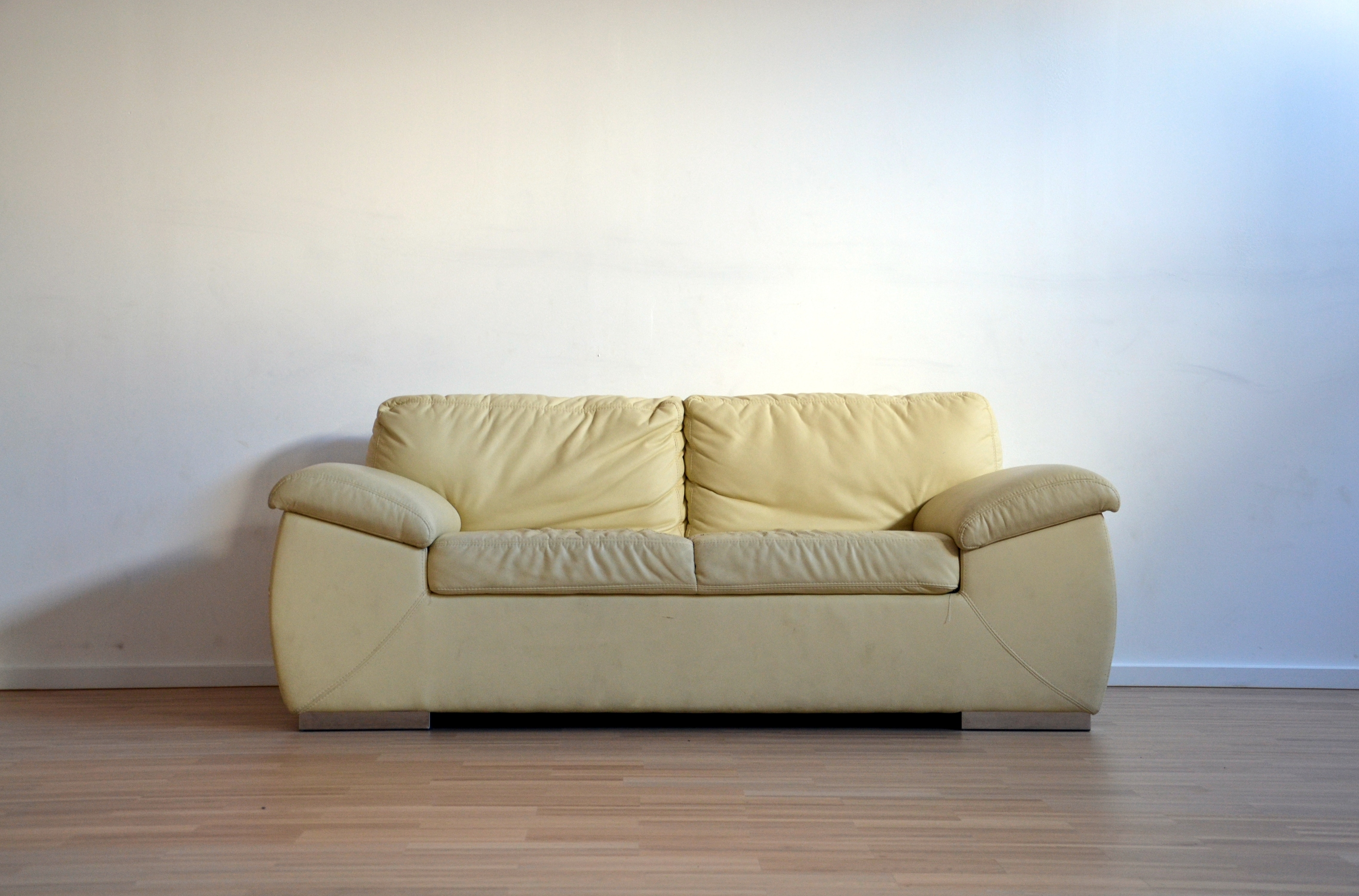 Cream sofa in empty room before upholstery Glasgow