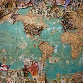 World map with money strewn across as people place bets for where certain snacks are from