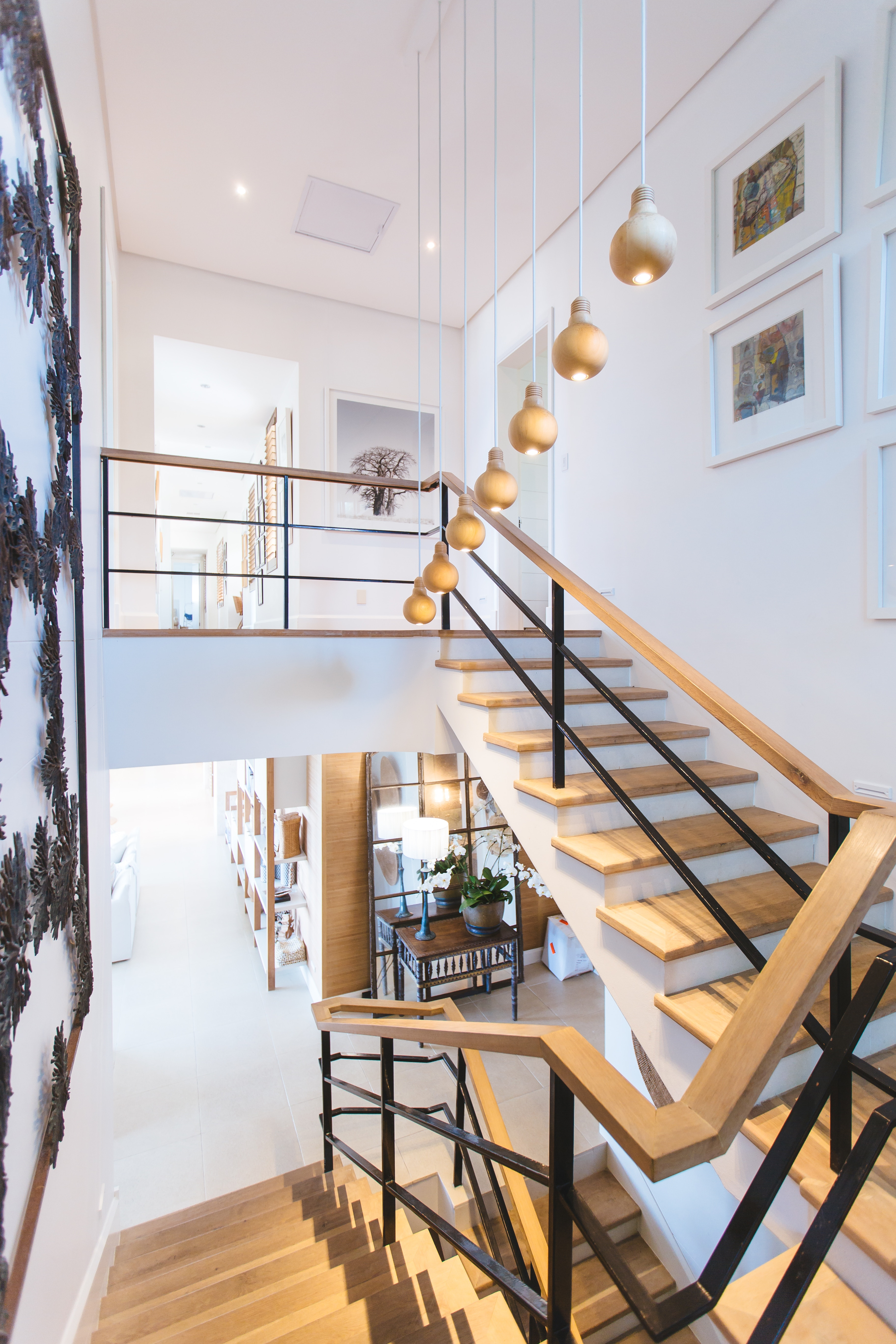Beautiful compete interior contractor home with wraparound wooden staircase.