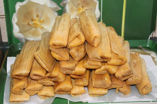Pile of tamales snacks on a table